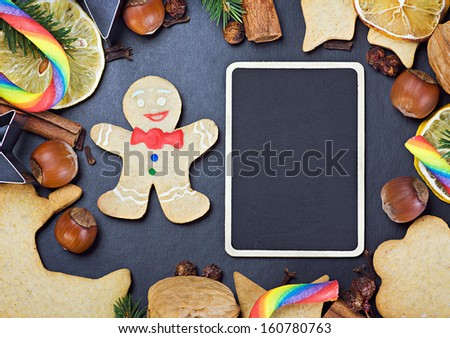 blackboard for gifts and ingredients for cooking and baking Christmas cookies