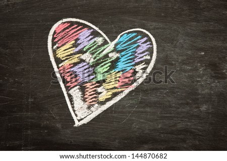 Blackboard heart - love concept, drawing heart with chalk on chalkboard