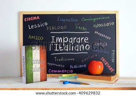 Blackboard in an Italian language classroom with the message Learn Italian and some other linguistic words. Stok fotoğraf ©