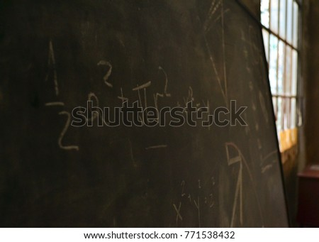 Blackboard inscribed by chalk with math and scientific formulas and calculations  #771538432