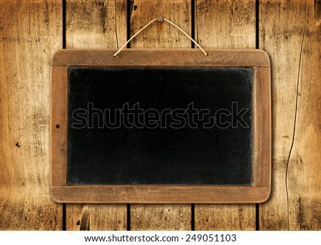 Blackboard on a old wood wall background texture