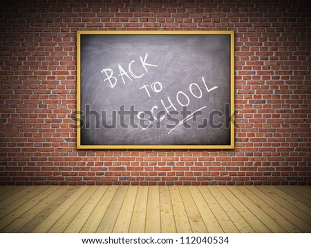 Blackboard on brick wall in interior. Back to school concept.