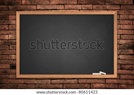 Blackboard on old wall background - stock photo