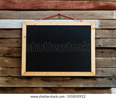 Blackboard on the wood wall.