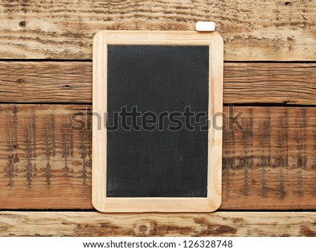 Blackboard on the wood wall.
