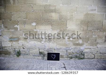 Blackboard on wall with heart, symbol of love detail, school blackboard wall, feeling