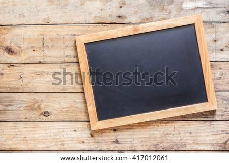 Blackboard on wood old wall