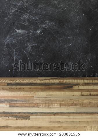 Blackboard wall and wooden floor background