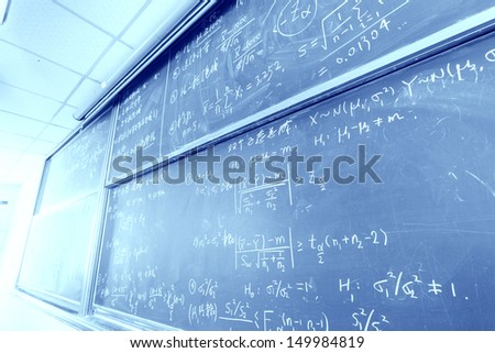 blackboard with complicated stastical math formulas