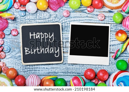 blackboard with congratulations to the happy birthday and photo frame