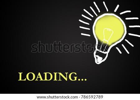 blackboard with glowing light bulb and progress bar #786592789