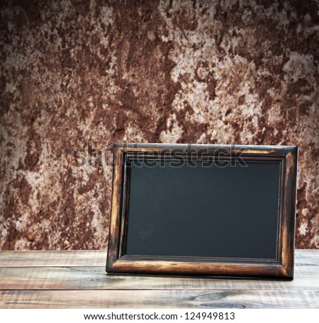 blackboard with space for text on the background of the old wall