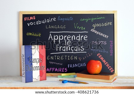 Blackboard with the message LEARN FRENCH and some text Stok fotoğraf ©