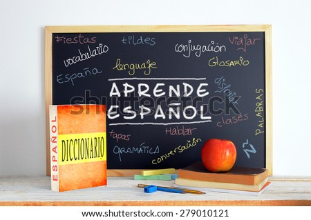 Blackboard with the message LEARN SPANISH and some text  Stok fotoğraf ©