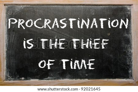 "Blackboard writings ""Procrastination is the thief of time"""