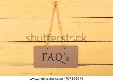 """Blackboards with inscription """"FAQ's"""" on yellow wooden background #709156072"""