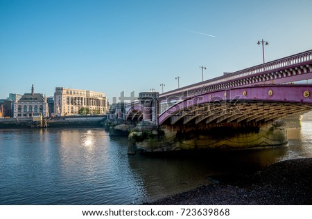 Blackfriars bridge across Thames River and Unilever House early in the morning, London, Great Britain