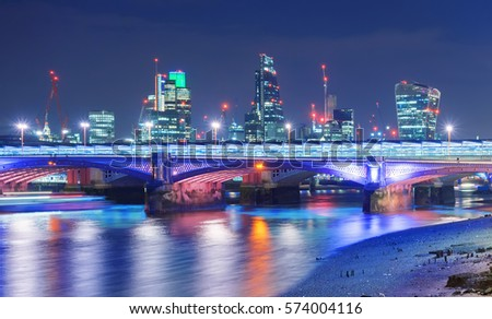 Blackfriars bridge in central London against the backdrop of the City of London financial district
