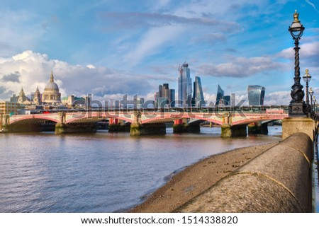 Blackfriars Bridge in London at sunset with a view of St Paul Cthedral and the City of London
