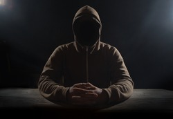 Blackmail. Hooded incognito isolated on black background