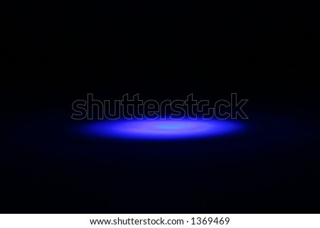 Blackout shot of a blue spot light, lighting effect