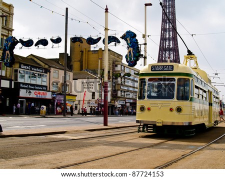 BLACKPOOL, ENGLAND - JUNE 28:Starr Gate tram runs along the Promenade, Blackpool Tower in background on June 28, 2009. Trams date back to 1885 and are one of the oldest electric tramways in the world.