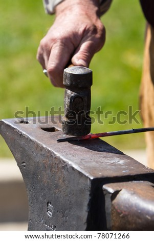 Blacksmith at work on a hot piece of metal