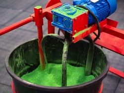Blade mixer for rubber crumb. Grinding green caoutchouc crumb. Mixing of rubber raw materials. Blade mixer while working. Production of rubber tiles concept. Recycling of caoutchouc process.