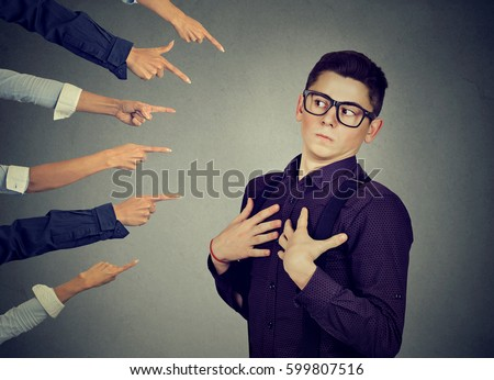 Blaming you. Anxious man in denial judged by different people who point fingers at him. Concept of accusation of guilty guy. Negative human emotions face expression feeling reaction  Stockfoto ©