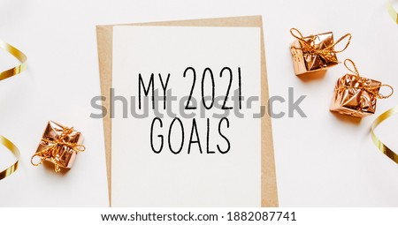 Blamy 2021 goals nk note with envelope, gifts and gold ribbon on white background. merry christmas and New Year concept Stock fotó ©