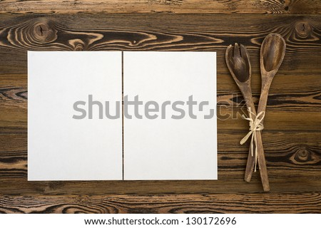 Blanc paper on rustic wooden background