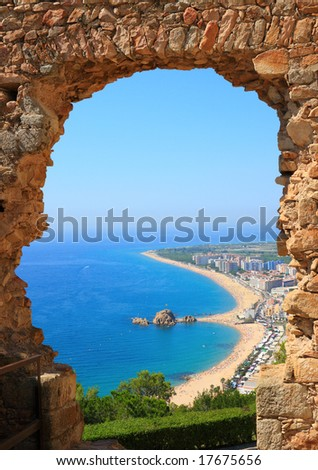 Blanes beach view through an arch  (Costa Brava, Catalonia, Spain) - stock photo