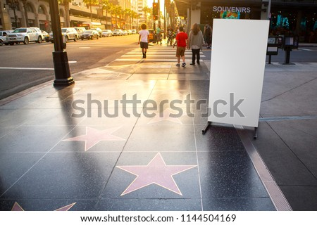Blank advertisement banner stand and Hollywood stars walk of fame in Hollywood Boulevard, LA California.  #1144504169