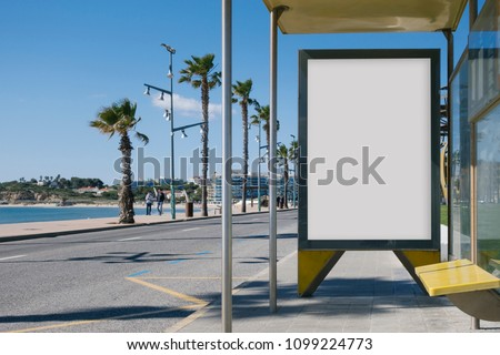 Blank advertisement in a bus stop, next to the sea