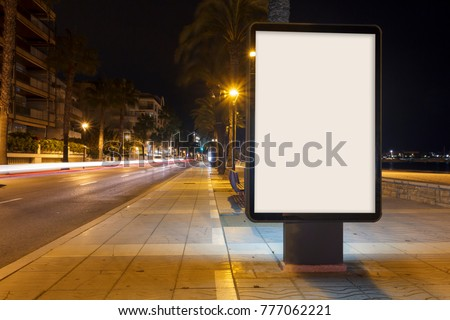 Blank advertisement mock up, in a footpath next to the sea at night