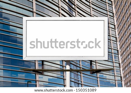 Blank advertising billboard and glass windows in office building