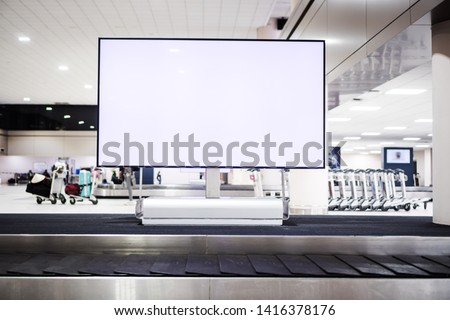 Blank advertising billboard at conveyor belt luggage in airport at airport. Copy space for customer text information advertise about tourism transport business etc.