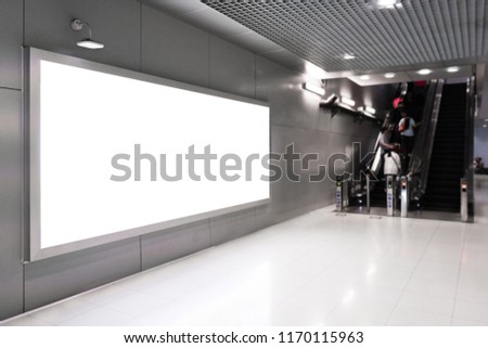 Blank advertising billboard in the Airport, blank billboards public commercial with passengers.