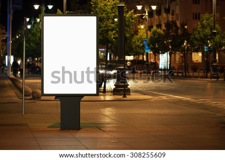 Blank advertising billboard in the city at night