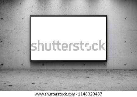 Blank advertising billboard led panel on concrete wall building street roadside background #1148020487