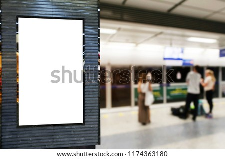 blank advertising billboard or showcase light box with copy space for your text message or media and content with people waiting subway at train station, commercial, marketing and advertising concept #1174363180
