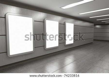Blank advertising billboards in underground passage