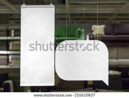 blank advertising flags hanging  in shop