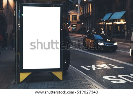 Blank advertising light box on the bus stop, mockup of empty ad billboard on bus station, template banner on background city street for message or text in Barcelona, afisha board