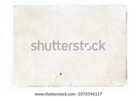 Blank aged paper sheet as old dirty frame background with dust and stains. Front view. Vintage and antique art concept. Detailed closeup studio shot. Toned #1073546117