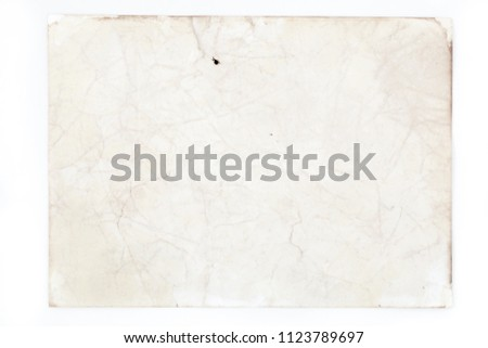 Blank aged paper sheet as old dirty frame background with dust and stains. Front view. Vintage and antique art concept. Detailed closeup studio shot. Toned #1123789697