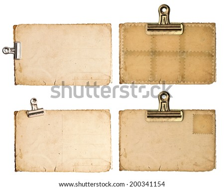 blank aged paper sheets with clip isolated on white background