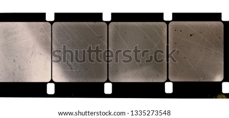 Photo of  blank and empty 16mm movie film strip, just blend in your content to get that old film effect