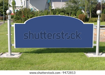 blank and wide sign with silver metal poles