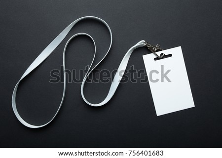 Blank badge mockup isolated on black. Plain empty name tag mock up hanging on neck with string. Name Tag, Corporate design. #756401683
